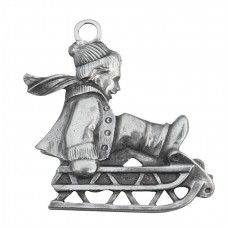 CHILD ON SLED SCULPTURED ORNAMENT